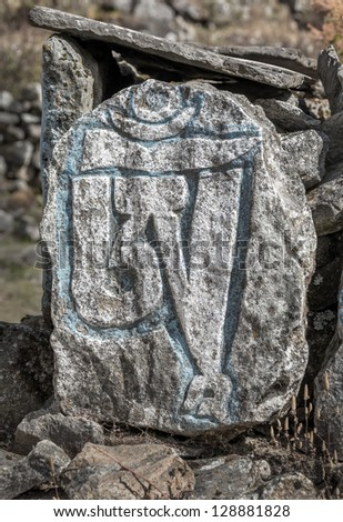 Carved stone tablets with the inscription Om syllables from Om Mani Padme Hum mantra - Everest region, Nepal, Himalayas