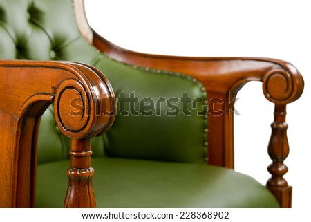 carved wooden armrest leather chair - stock photo