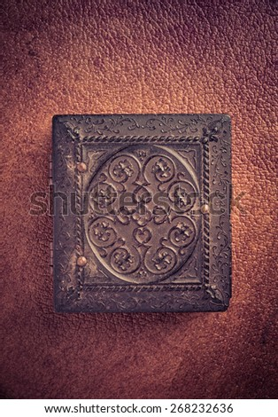 Carved wooden case over leather background. - stock photo