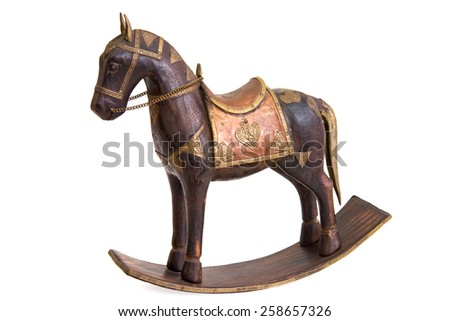Carved wooden horse figurine on white background