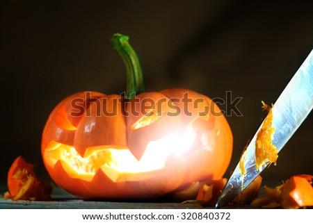 Carving a Halloween jack o' lantern - stock photo