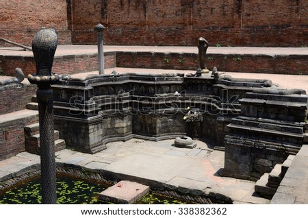 Carving decorations depicting hindu mythology in the water reservoirs in Bhaktapur Durbar square , Kathmandu, Nepal,Asia,unesco heritage