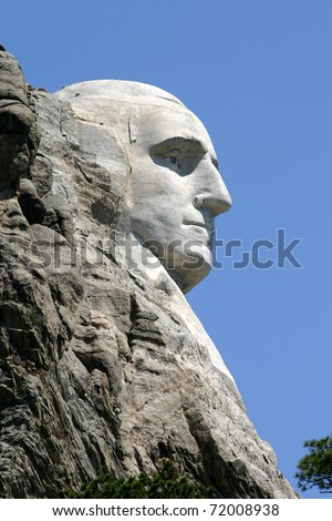 Carving of George Washington's face at Mount Rushmore National Park - stock photo