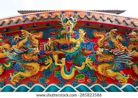 Carving of golden dragons on the wall - stock photo