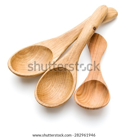 Carving wooden spoon isolated on white background cutout - stock photo