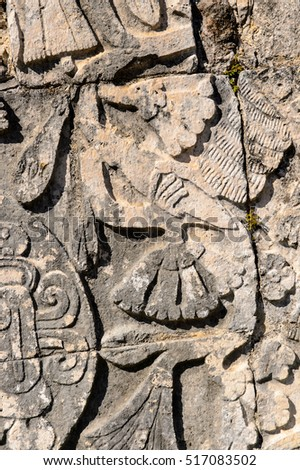 Carvings on a temple of Chichen Itza, Tinum Municipality, Yucatan State. It was a large pre-Columbian city built by the Maya people of the Terminal Classic period. UNESCO World Heritage
