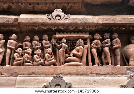 Carvings on temple walls at Khajuraho - stock photo