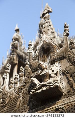 Carvings on top of Shwenandaw Kyaung, Mandalay, Myanmar - stock photo