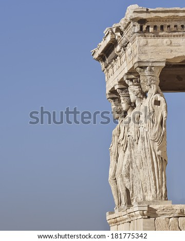 Caryatids ancient Greek statues, and blue sky as space for text - stock photo