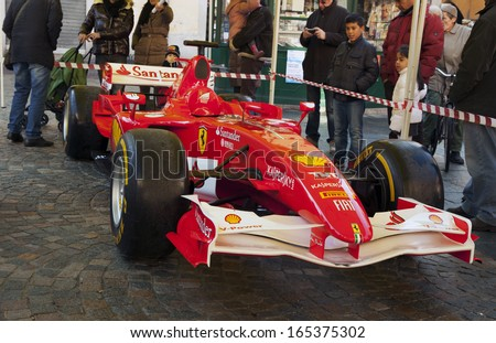 """CASALE MONFERRATO, ITALY - DECEMBER 1ST: Single-seater Formula 1 Ferrari in """"Christmas Fair"""" in piazza Mazzini, December 1, 2013 in Casale Monferrato, Italy - stock photo"""