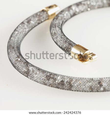 CASALE MONFERRATO, ITALY - JANUARY 7, 2015: Swarowski Stardust bracelet over black background. Swarowski is a leader brand for crystal and jewels - stock photo