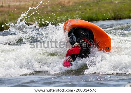 CASCADE, IDAHO/USA - JUNE 21, 2014: Unidentified person working a trick during the Payette River Games