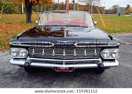 CASCADE, MD - OCTOBER 19: Front detail of a Chevrolet Impala at the King of the Mountain Car Show on October 19, 2013 in Cascade, MD.  Proceeds from the event benefit the Children's Miracle Network. - stock photo