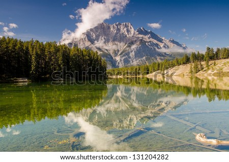 Cascade Mountain overlooking a calm lake in Banff - stock photo