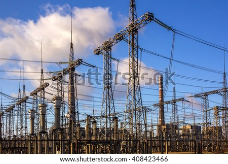 cascade of high-voltage lines against the background of electrical distribution stations .