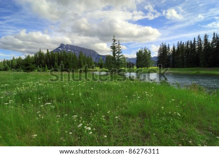 Cascade Ponds near Banff in Banff National Park Canada. These picturesque ponds are surrounded by the Rocky Mountains. Mount Rundle in the background. - stock photo