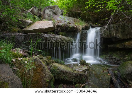Cascade waterfall in forest, Hesslacher Waterfalls, Stuttgart, Germany - stock photo