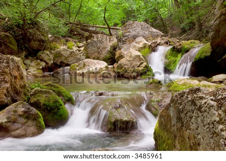 Cascades in spring forest in Crimean canyon