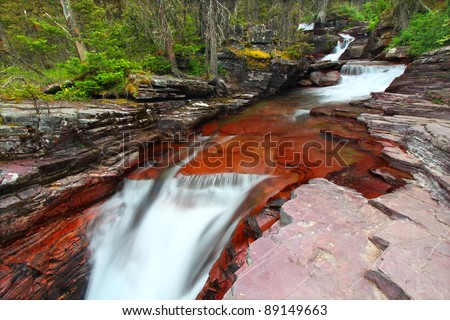 Cascades of a beautiful mountain stream in Glacier National Park in Montana - stock photo