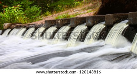 Cascades of water at the Bond Falls Scenic Site in Michigan - stock photo