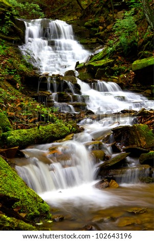 Cascading waterfall during spring located in Oil Creek State Park.