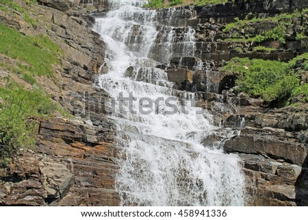 Cascading Waterfall in Glacier National Park - stock photo