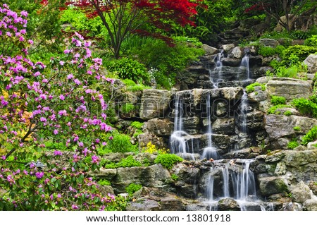 Cascading waterfall in japanese garden in springtime - stock photo