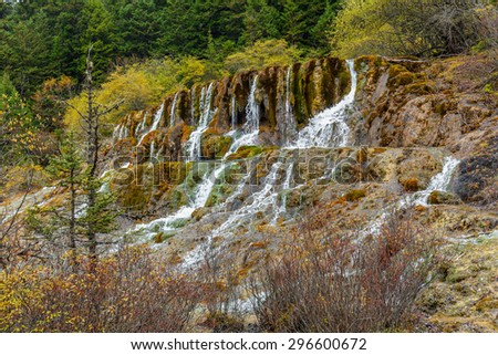 Cascading waterfall. Jiuzhaigou Valley was recognize by UNESCO as a World Heritage Site and a World Biosphere Reserve - China - stock photo