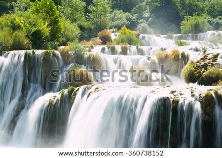 Cascading waterfalls, National park Krka. Cascading waterfalls. Waterfalls. National park. Water park. Fresh water. Scenery waterfalls. Waterfalls background. - stock photo