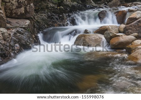 Cascading white water in Kenyir lake, Malaysia. - stock photo