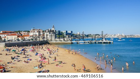 CASCAIS, PORTUGAL - JULY 15, 2016: Famous beach in the Bay of Cascais, a Portuguese coastal town 30 km west of Lisbon.