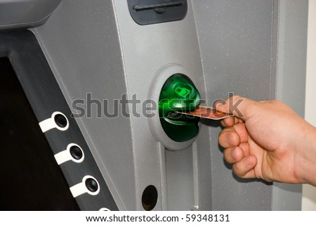 Cash dispense and the inserted plastic card - stock photo