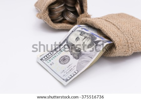cash dollar in gunny back on white background - stock photo