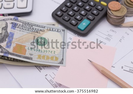 cash dollars and calculator on business documents background - stock photo