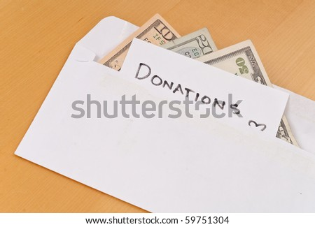 Cash Donations in Envelope - stock photo