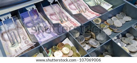 Cash drawer with thai currency inside - stock photo