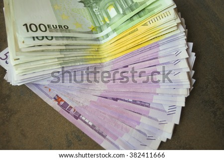 Cash Euro banknotes spread out on the table. - stock photo