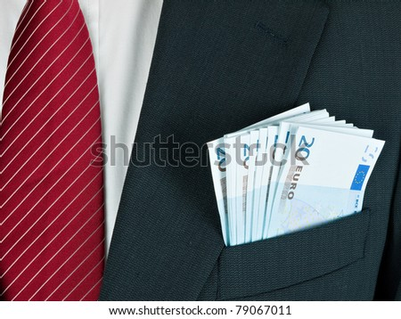 Cash, Euros, in businessman's pocket - just business or bribery and corruption maybe