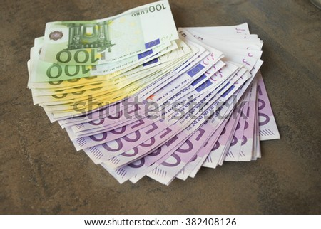 Cash five hundred Euro banknotes spread out on the table. - stock photo