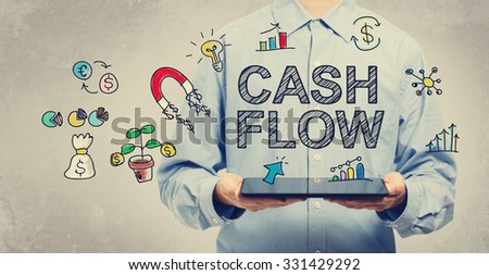 Cash Flow concept with young man holding a tablet computer  - stock photo
