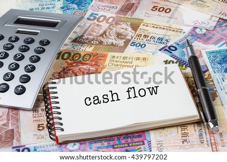 Cash flow - Stack of Hong Kong dollar or banknotes with notepad and calculator conceptual - stock photo