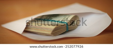Cash in an envelope. Shallow depth of field.
