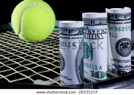Cash in the sport of tennis. - stock photo