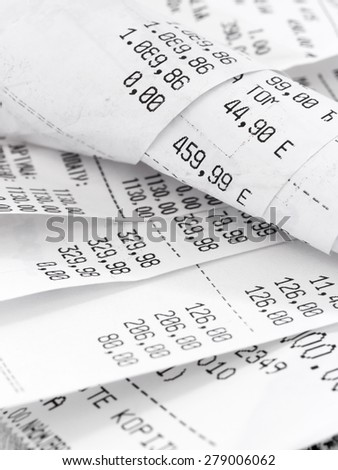 cash register receipts in a pile - stock photo