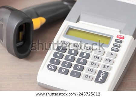 Cash register with a barcode reader - stock photo