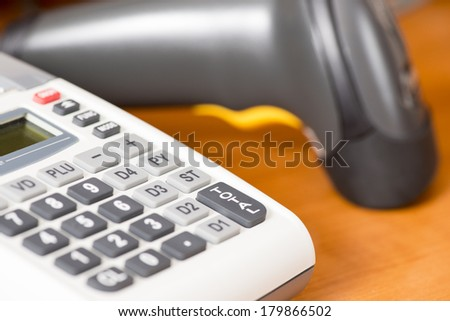 Cash register with barcode scanner against the background - stock photo