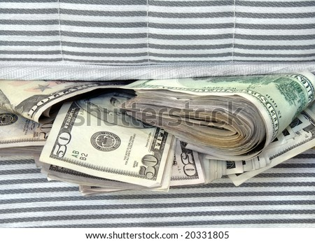 Cash stashed for safe keeping in between mattresses.
