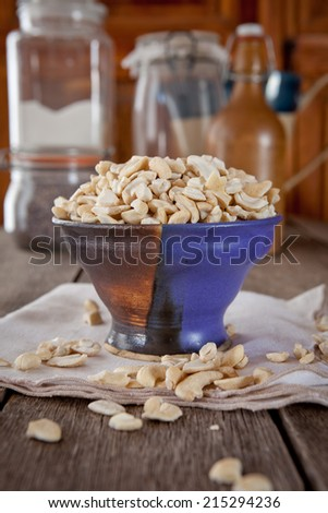Cashew nut pieces in a handmade ceramic bowl - stock photo