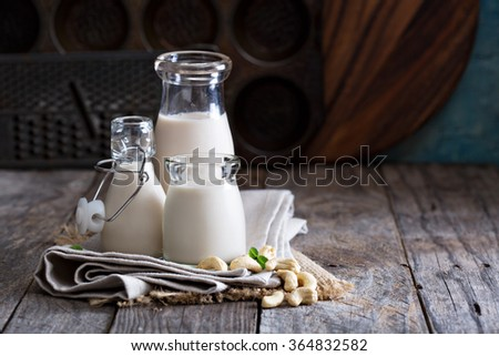 Cashew nut vegan milk non dairy in different bottles with copy space - stock photo