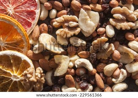 Cashew nut, walnut, hazenut, almond, dry orange and dry grapefruit - stock photo